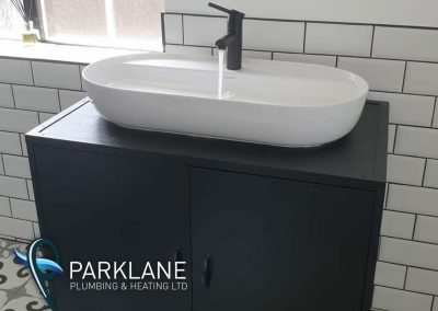 Floor standing basin with cifial matte black tap and waste.