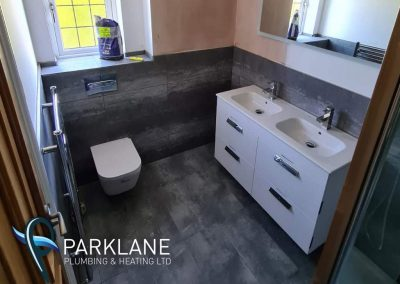 His and hers large vanity unit it installed in a new build property
